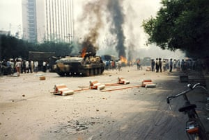 Tiananmen protests 1989: Armoured vehicles are set ablaze by civilians, Fuxing Road