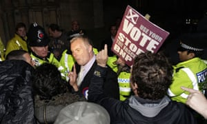 Demonstrators confront a British National Party member