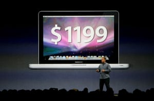 Apple conference: Philip Schiller stands under a picture of the 13-inch MacBook Pro
