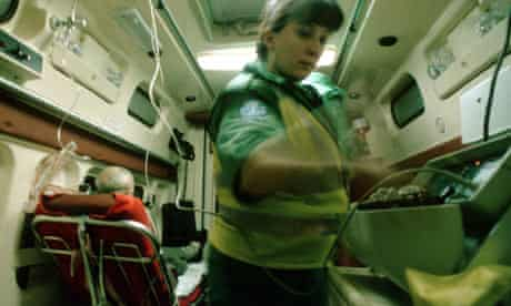paramedics attending to the victim of a heart attack in an ambulance