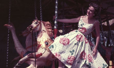 Woman in dress on merry-go-round