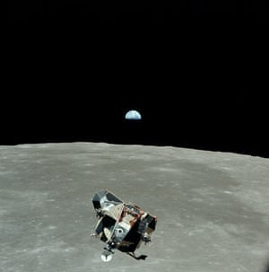 Apollo 11 : The Eagle,  the lunar module, prepares to dock with the command module