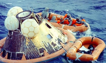 Apollo 11 crew in isolation suits after splashdown