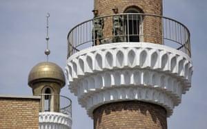 Dan Chung in Urumqi: Security forces on a mosque roof in Urumqi