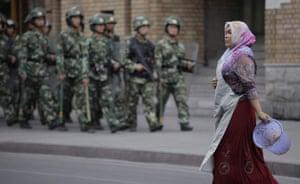 Dan Chung in Urumqi: Security forces on patrol near a mosque in Urumqi