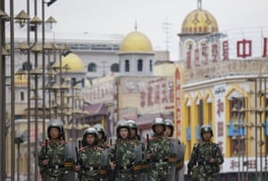 Dan Chung in Urumqi: Security forces on patrol near a mosque