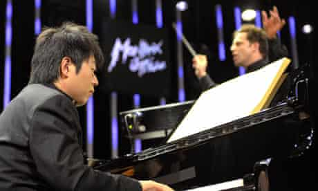 Lang Lang performs in front of John Axelrod