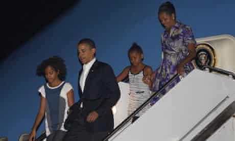 President Obama and his family return to Washington