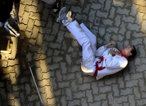 24hours in pictures: Man after been gored by a Miura fighting bull at San Fermin festival Spain