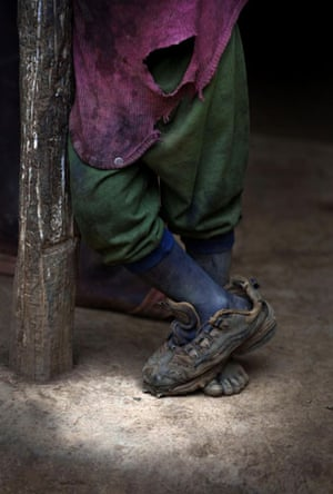 24hours in pictures: A child stands at his home in Mabriyole, Haiti