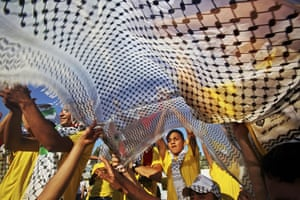 24hours in pictures: Palestinian ruling Fatah supporters, chant slogans during a ceremony