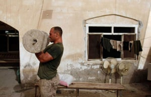 24hours in pictures: U.S. Marine Addison Chipoletti uses a makeshift weight to workout