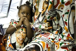 24hours in pictures: Girl sits as she waits for President Barack Obama's arrival in Ghana