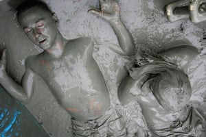 24hours in pictures: Participants during the 12th Annual Boryeong Mud Festival South Korea