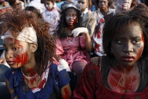 """24hours in pictures: People dressed as zombies, prepare to perform Michael Jackson's """"Thriller"""""""