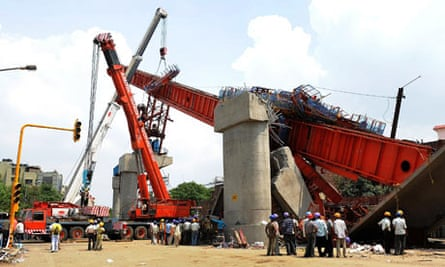 The site where a pillar supporting a new bridge for the Delhi metro collapsed