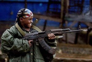 Charles Taylor: 2003: A nine year old Liberian government gunman fires down the Old Bridge