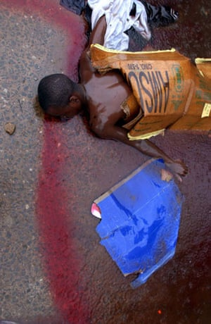 Charles Taylor: 2003: A man lies dead on a street in Monrovia