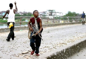 Charles Taylor: 2003: A Liberian child soldier fighting for Charles Taylor's forces