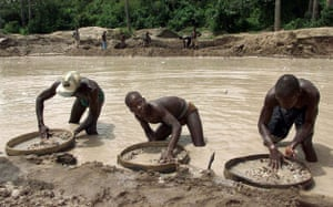 Charles Taylor: 2000: Diamond prospecters sift at the Corbert mine in Waiima, Sierra Leone
