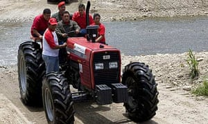 Hugo Chavez drives a tractor during his weekly broadcast, Alo Presidente, in the state of Aragua.