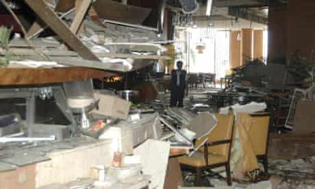 A forensic investigator inspects the restaurant at the Ritz-Carlton hotel in Jakarta
