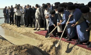 Turkmen elders open a drain channel to start filling the country's Golden Age Lake.