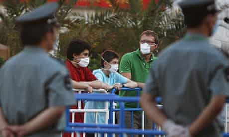 Quarantined British students and a teacher outside the Yanxiang hotel in Beijing.