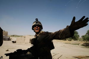 Operation Khanjari: A Marine yells to his colleagues as they take enemy fire