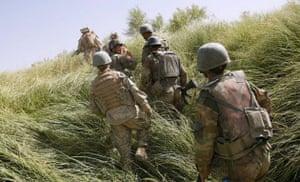 Operation Khanjari: Soliders and Marines patrol together during the start of Operation Khanjari