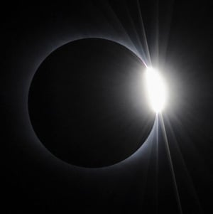 eclipse: The sun emerges behind the moon just after eclipse