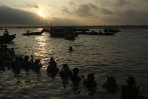 eclipse: Hindus in the River Ganges during the solar eclipse in Varanasi