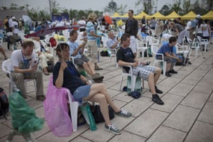 eclipse: Western tourists sit in the rain ahead of the eclipse in Jiaxing, Chin