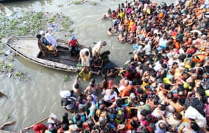 eclipse: attempted rescue of devotees from the Ganges in Varanasi during eclipe
