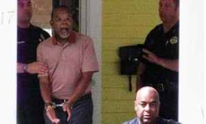 In this photo taken by a neighbor on 16 July 2009, Henry Louis Gates Jris arrested at his home