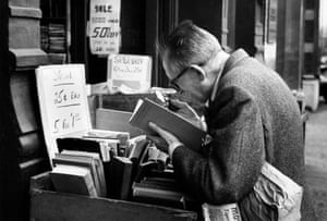 On Reading: André Kertész man reading with magnifying glass