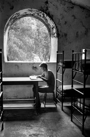 On Reading: André Kertész young man seated near window