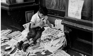 Boy reading newspaper, New York, 1944