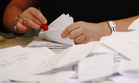 An assistant counts ballot papers at the Norwich by-election