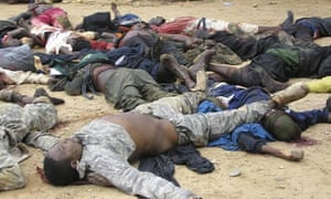 Dead Nigerians are brought to a police station in the northeastern city of Bauchi