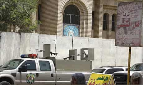 A police vehicle outside the Rafidain bank in Baghdad