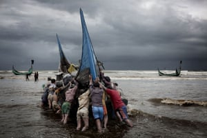 Bangladesh flood defences: After a day of fishing in Bengal Bay, the boats returns to the beach