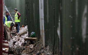 Peace walls in Belfast: Workmen build a new section of Belfast's peace wall