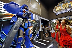 China Digital Expo: Two women look at a character from Blizzard's forthcoming video game