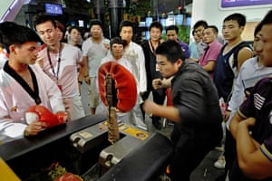China Digital Expo: A visitor tries an electronic punching machine