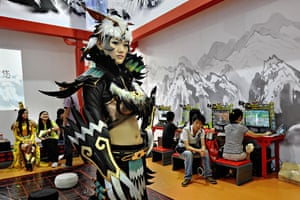 China Digital Expo: A video game character stands at a booth