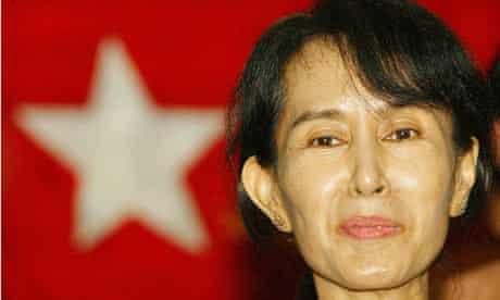 Myanmar democracy leader Aung San Suu Kyi listens