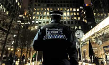 A security guard at  Canary Wharf, London.