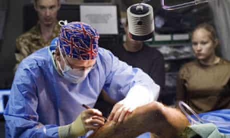 A surgeon operates at Camp Bastion