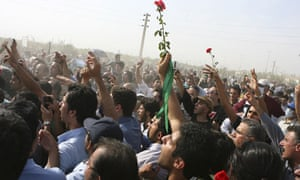 Protesters chanting slogans at an opposition rally at the Behesht-e-Zahra cemetery, Tehran, Iran